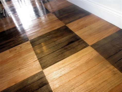 how to a wood floor down to earth style how to paint a rug on wood floors