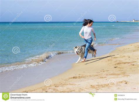 girl dog run stock photo image  woman spring sand