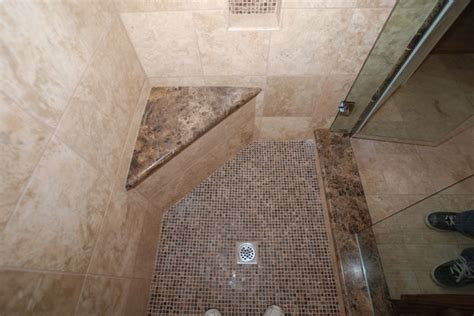 marble and travertine with kohler fixtures and