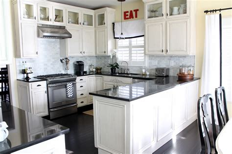kitchen white cabinets dark countertops give