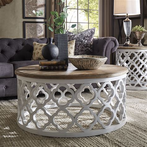 Books, flowers, and a decorative object are the usual pieces you'll find on a coffee table. 14 Round Coffee Table Decor Ideas Gallery