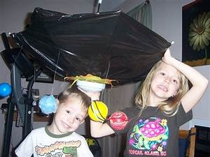 Solar System School Project Using Umbrella Upside Down And