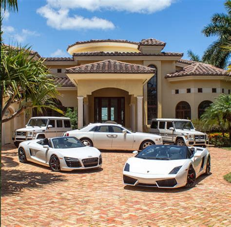 home with car a look at some mansions with expensive cars parked in front homes of the rich