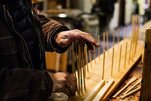 Canoe maker David Moses Bridges reflects as he faces a