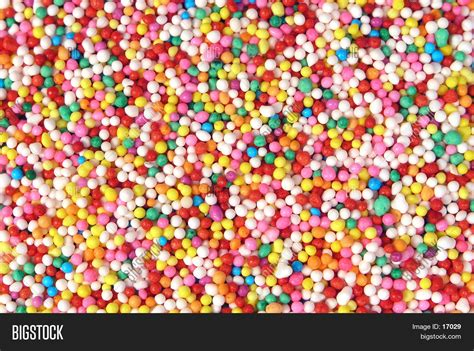colored sprinkles colored sprinkle background stock photo stock images