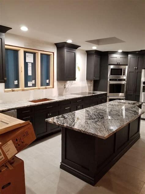 modern kitchen reno white granite countertops dark