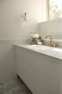 bathroom with white subway tiles on upper walls and board With tiles on board for bathrooms