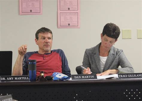 trojans pass budget approve staff eliminations local
