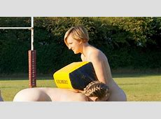 Women's rugby team strip down to just their club socks and