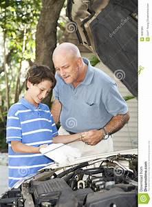 Dad Teaches Son To Check Oil Stock Image - Image: 18367891