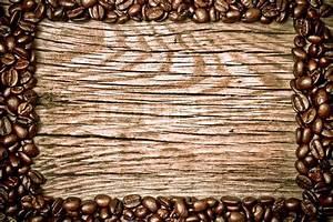 Coffee beans on wood texture | Stock Photo | Colourbox