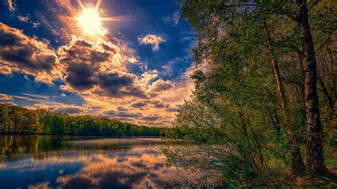 landscape nature peaceful river coast  tall trees sky