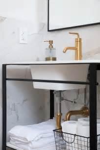 sunburst mirror  gold trim transitional bathroom