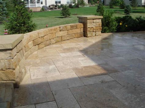 the limestone patio pavers and wall for the home