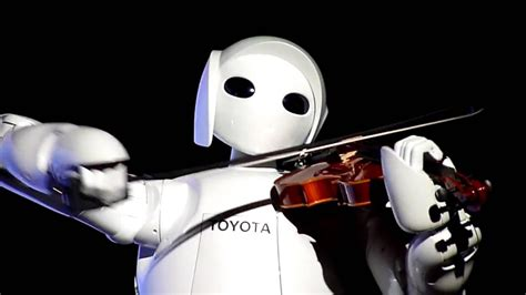 Violin-playing Robot. Robot Which Can Play The Song On Violin