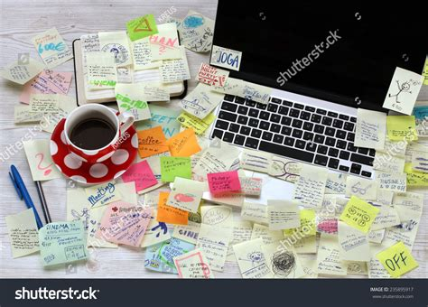 post it bureau pc office desk with laptop covered by post it papers stock photo 235895917