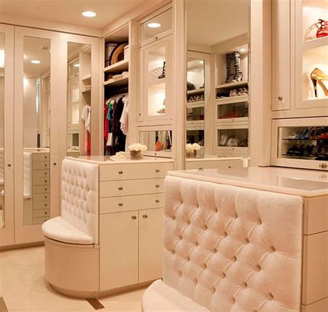 walk in closet with bench and drawers decoist