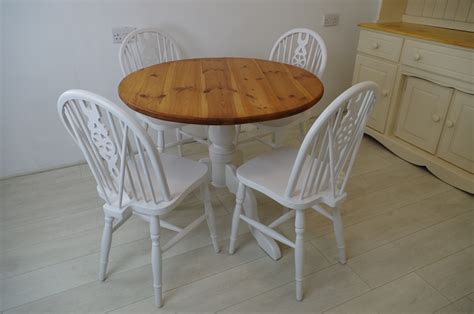 pine pedestal table and 4 wheelback chairs painted