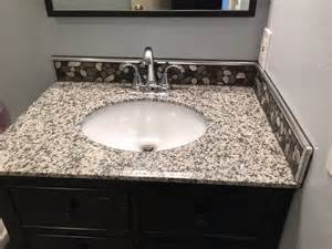 aluminum flat pebble bathroom backsplash clearwater florida ceramictec updates
