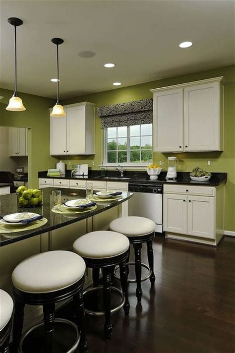 love  kitchengreen walls white cabinets