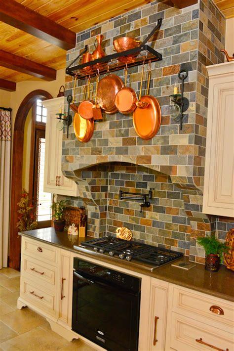 world style kitchen  slate tile  copper pots hgtv