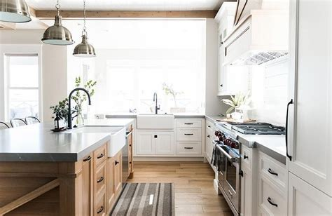 Shaker style kitchen with white cabinetry and black appliances. White shaker cabinets accented with oil rubbed bronze ...