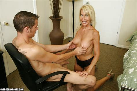 Busty Mature Blonde Gives A Tugjob And Gets A Cumshot On Her Tits