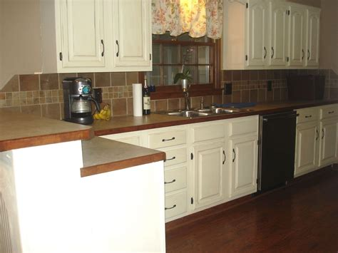 brown cabinets with white countertops brown kitchen cabinets with white backsplash quicua com
