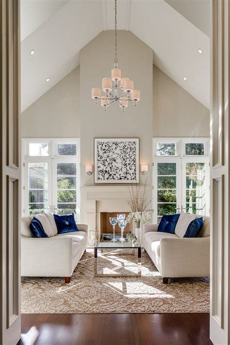 Benjamin Moore Manchester Tan Living Room Traditional With. Kitchen Hood. Indoor Hot Tub. Screened In Porches. Yellow Coffee Table. Wrap Around Shower Curtain. Pendent Lights. Blue And White Rug. Sater Design