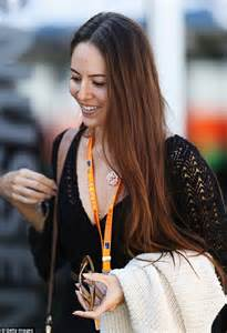 shaped engagement ring michibata goes for the retro look as she cheers on fiance jenson button in gold rimmed