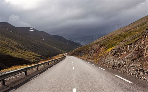 Dark Clouds Above The Mountain Road Wallpaper