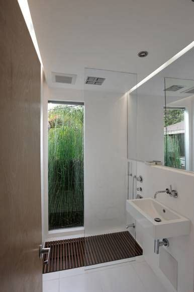 sunken tub floor  ceiling window  horsetail planted