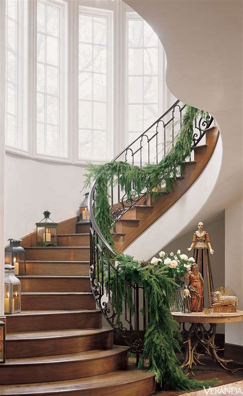 garland staircase decorating step into the christmas spirit with a garland draped staircase designed