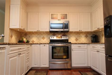 transitional kitchen with white cabinets and granite