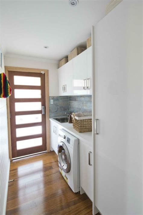 Monochrome House With Secrete Utility Room by For Laundry Great Walk Through Style With Door Letting