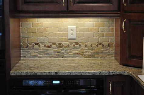 tumbled backsplash and new venetian gold granite