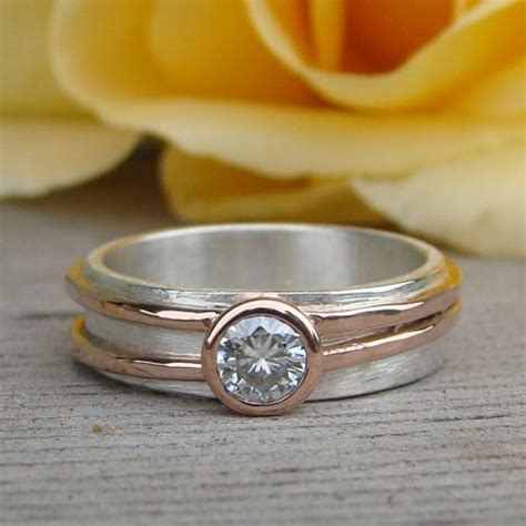 moissanite engagement or wedding ring with recycled 14k rose gold and recycled sterling silver