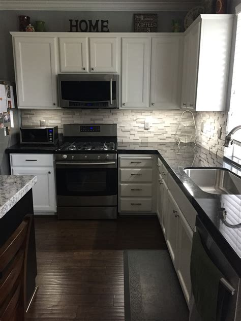 backsplash for kitchen with granite black granite with a gray backsplash for the home