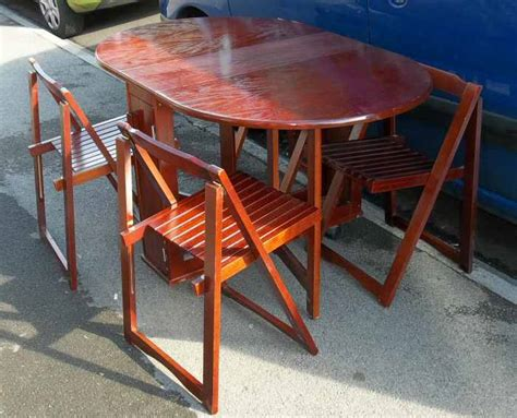 Cherry Coloured Folding Kitchen Table And Four Chairs
