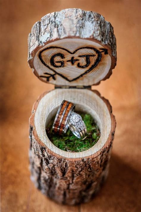woodburnt stump ring box filled with moss weddings and wedding ring box rings