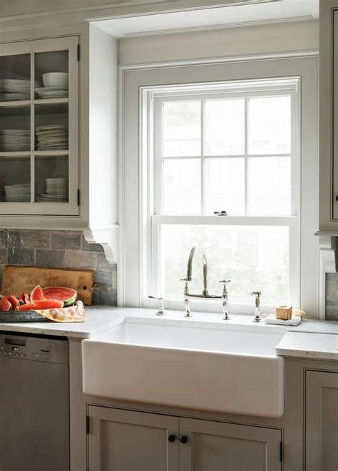white kitchen cabinets with rubbed bronze hardware cottage kitchen features light gray shaker cabinets 2261