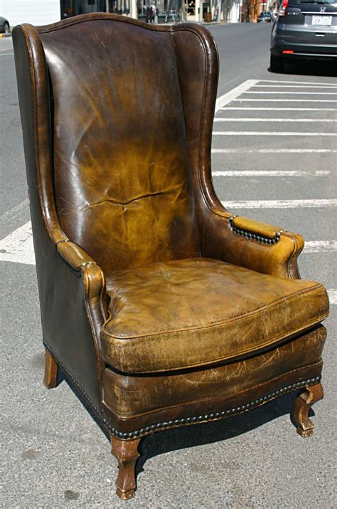 distressed leather wingback chair high chair leather
