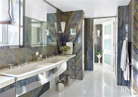 transitional neutral bathroom  brazilian marble walls