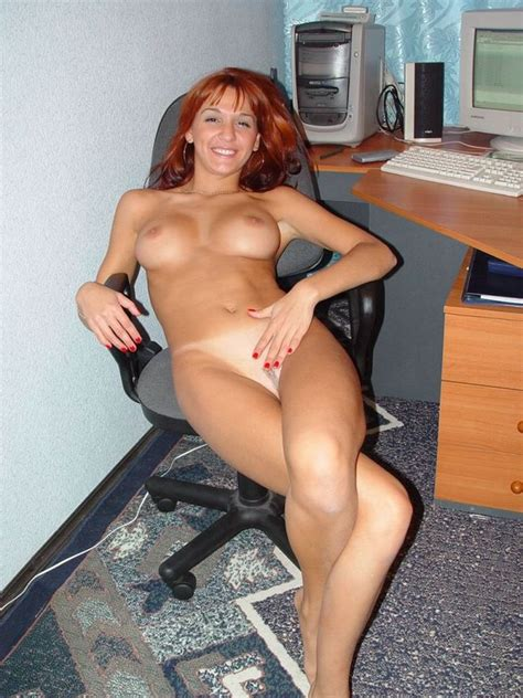 Redhead And Cheerful Secretary Posing Naked At Full Size Image