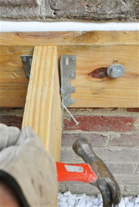 deck joist hangers nails how to build a deck adding the joists house