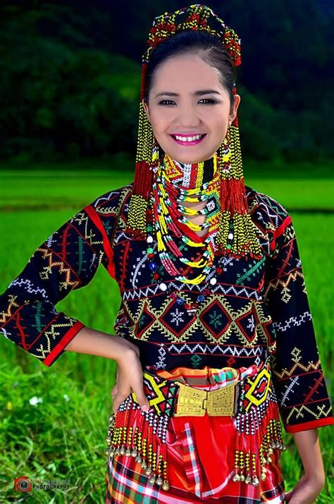 colorful  bejewelled tboli woman filipino clothing