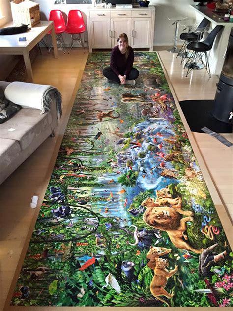 girl  finished  worlds largest jigsaw puzzle