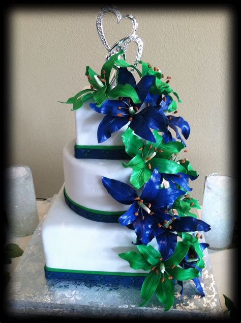 wedding cake with green and blue sugar lilies emerald green weddings navy blue wedding cakes