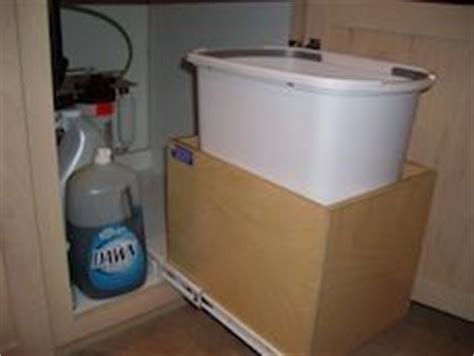 trash bin shelf by the pull out shelf company pull out