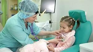 Happy child at doctor's reception, medical examination ...
